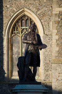 The statue of Gainsborough in front of St Peters Church in Market Hill, taken from further away
