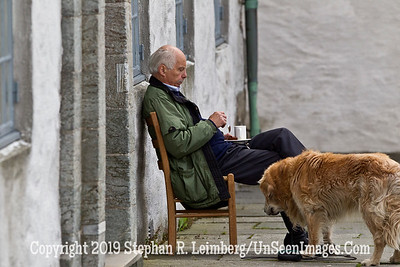 Man and Dog in Bergen GLACIER AND BERGEN_110827_0985