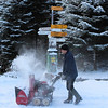 Switzerland, Lucerne, Mt Pilatus, Clearing a walking path with a hand driven snow machine
