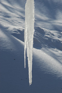 Frozen icicles against snow in Leukerbad