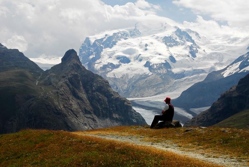 Hiker taking in the view - Furi, Switzerland