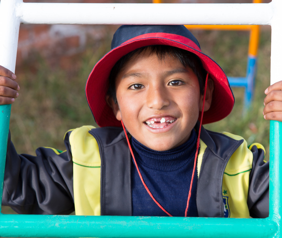 The playground equipment created a natural frame for this handsome young man.