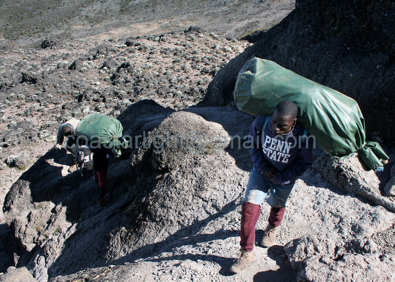Porters climbing the Great Barranco Wall