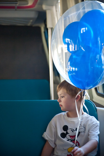 Vincent with his new balloon on the Monorail.