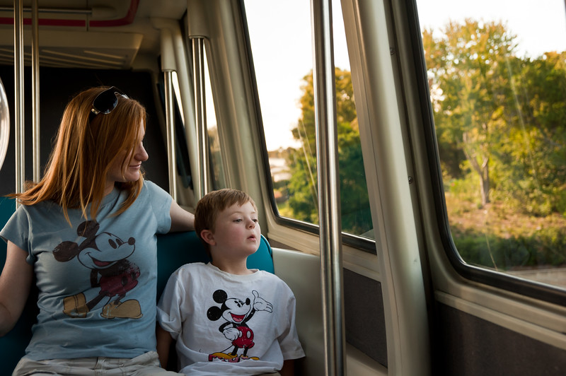 Marisa and Vincent riding the monorail to Epcot in their (almost) matching Mickey shirts.