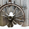 background old rusty wheel and board wall