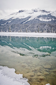 Early winter reflection - mountains and snow - North Saskatchewan River, Banff National Park