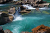 Beautiful azure waterfall pool on the upper Fraser River at Rearguard Falls in the springtime.