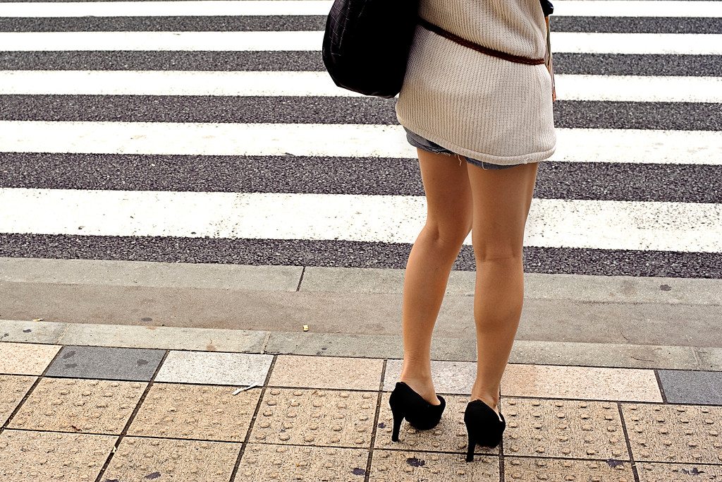 Tokyo's legs<br /> <br /> One unexpected discoveries about Tokio's culture, was women's obsession with short skirts, high heels & boots. <br /> <br /> Nikkor 50 f1.4 @ f8