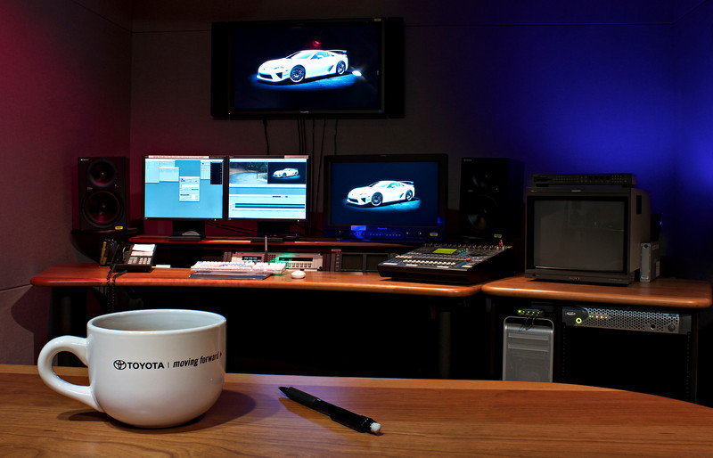 This is 'EDIT 7', the room I work in most of the time. It is an AVID non-linear HD (High Definition) digital editing bay. The car on the monitors is the new LFA sports car from Lexus. You can order one if you happen to have $375,000 burning a hole in your pocket. Of course the room doesn't always look this clean, or have the cool red and blue lighting. This image took 2 exposures to obtain an extremely wide DOF. One for the foreground and one for the background. They were merged in Photoshop for the final composite.