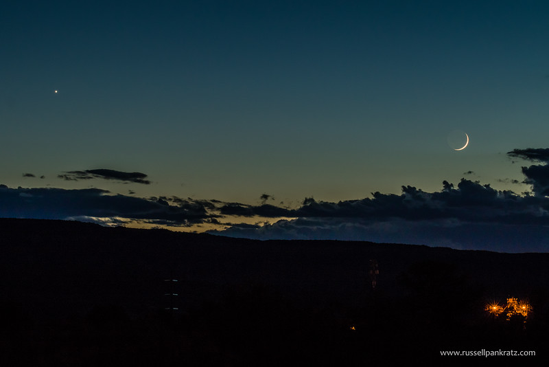 Bright Venus joins the New Moon in the western sky after sunset.