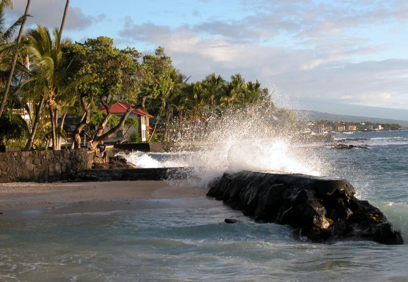 Waves breaking over the rock in Kona