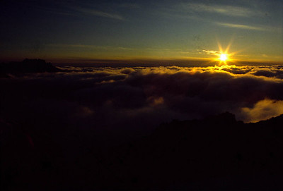 This is sunset above the clouds from the top of Snow Dome.  That's Mt. Tom just piercing the clouds west of Mt. Olympus.
