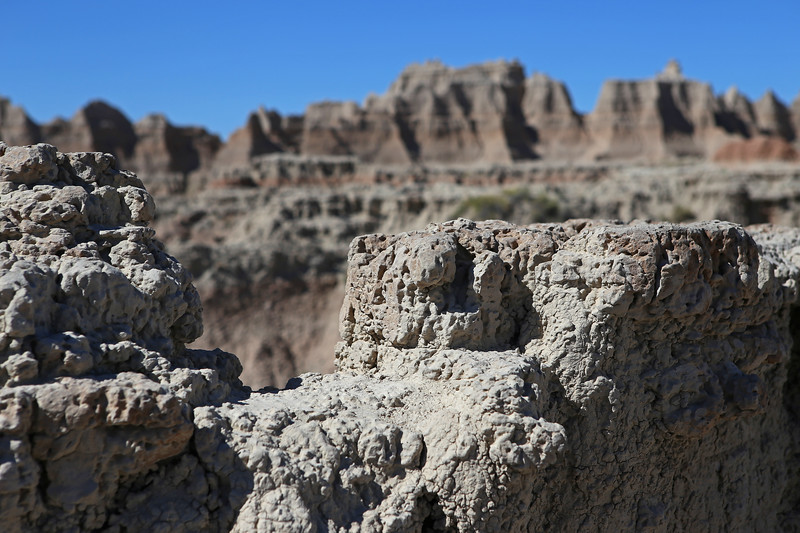 September 20, 2017 - Badlands National Park. Door Trail. View north from the Door Trail. This material is hard rock. The redish colored material is loose gravel.