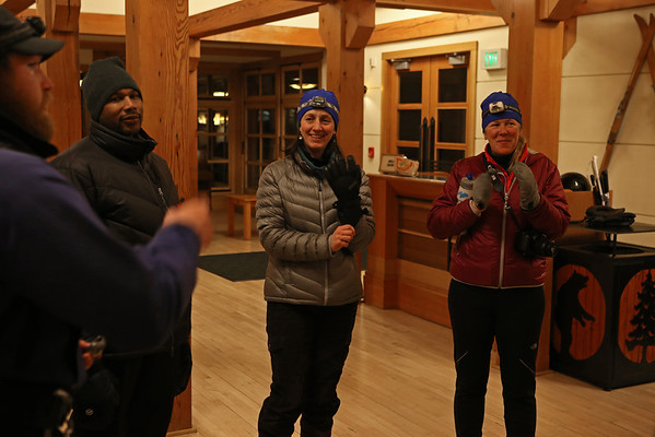 Zephyr Adventures. February 17, 2014. Preparing for night tour of Castle Grand and Geyser Hill areas. Lobby, Snow Lodge, Yellowstone National Park. L-R: guide, Micheal Henderson, Sonya Mapp, Kris Thomas Keys.