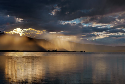 Rainstorm at sunset over the western shore of Mono Lake, California.