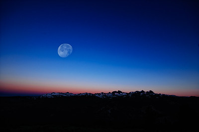The setting moon as the sun rises at Minaret Vista.