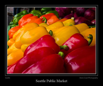 Red, orange, and yellow peppers for sale at a vendor inside the Seattle Public Market