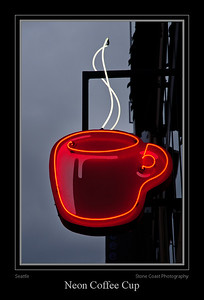 Neon coffee cup sign outside the Seattle's Best shop at the corner of Pine Street and Post Alley in Seattle.