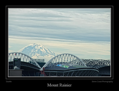 Mount Rainier with the roof structures of Centurylink Field and Safeco Field in the foreground.
