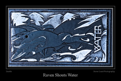 Raven Shouts Water is an artistic cover for a water district hatch cover in Seattle, Washington. The design is by artist Barbara Earl Thomas.