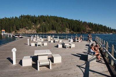 The floating Coeur d'Alene boardwalk is basically boats for pedestrians. I walked around it a few times snapping pictures. Note the woman on the right giving me the stink eye. These days it's perfectly okay to walk around like a self-absorbed imbecile talking to your phone but it's still considered weird to stand on benches and take pictures.