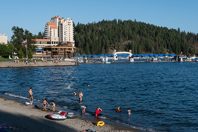 "Late afternoon City Park swimmers in Lake Coeur d'Alene. The Coeur d'Alene resort and floating boardwalk are in the background. We were pleasantly surprised by Coeur d'Alene and the lake. It's more ""boutiquey"" than Tahoe and just as beautiful. Not social justice warrior approved!"