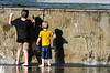 Boys playing in the main fountain in Ann Morrison Park.