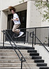 We walked around downtown Boise this afternoon and came upon a group of skooter riders launching themselves off stairs. I shot about two dozen kids flying, kids landing, and kids wiping out pictures. This is my favorite shot. Make sure you have big hair when making big air.