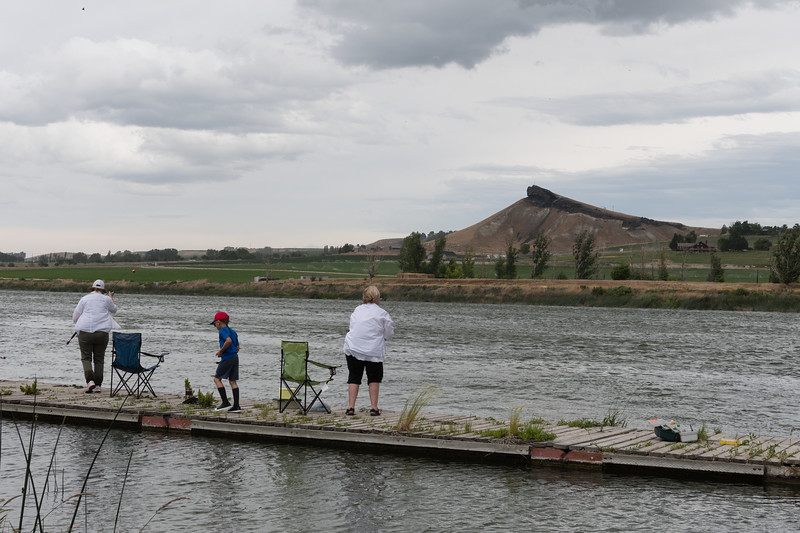 Fishing on the banks of the Snake River in Marsing. I climbed up Lizard Butte, the distinctive dark landform on the other side of river, shortly after taking this picture.