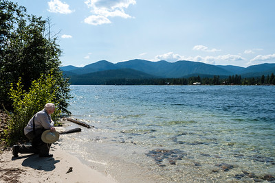 Me kneeling on a small beach at the northern end of Priest Lake.