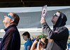 Eclipse profiles. I've run around taking pictures of people at a number of solar eclipses. People are so absorbed by the spectacle that they relax and become good models.