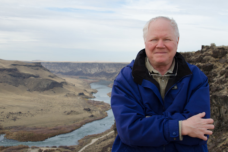This was the first weekend we got out and started exploring the landscape around Boise. Here I am standing at Dedication Point on the northern side of the Snake River Canyon. The Snake River plain is covered with young, (for rocks), basalt and rhyolite lava flows that have repeatedly blocked the Snake River. The river keeps patiently cutting through the rock. In a mere million years it has cut the canyon behind me. The land around Dedication Point is a major bird of prey nesting area. Hawks, peregrines, and eagles set up nests on the canyon cliffs and feed their chicks a prairie dog enriched diet. Dedication Point is also used as a dark sky observing site for the local amateur astronomy society. The view to the south should be pretty dark. There are no close cities or towns to the south. The north will be compromised by Boise's lights.