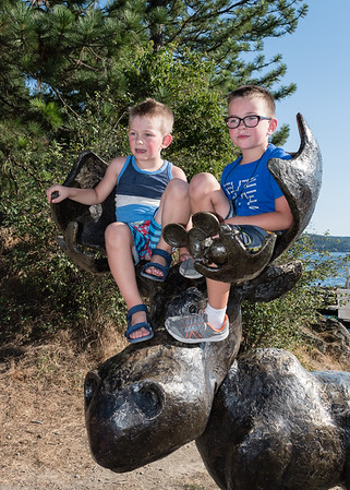 Boys on a moose sculpture in McEuen Park.