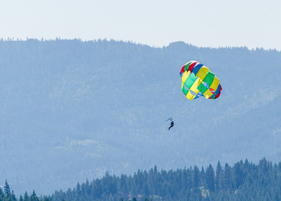 The weather was simply perfect during our recent northern Idaho visit so people were out zealously pursuing summer activities. The most zealous took to the air. All-day long you could spot people parasailing on Lake Coeur d'Alene. The parasailers were too far offshore for decent shots. This is the best of my 300mm shots.