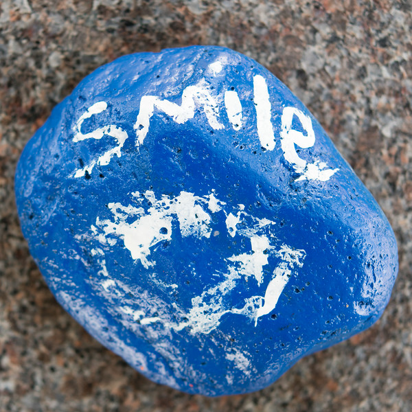 Someone left a blue painted rock on a cemetery bench reminding us to smile. I presume because we are walking around the cemetery rather than lying in it.