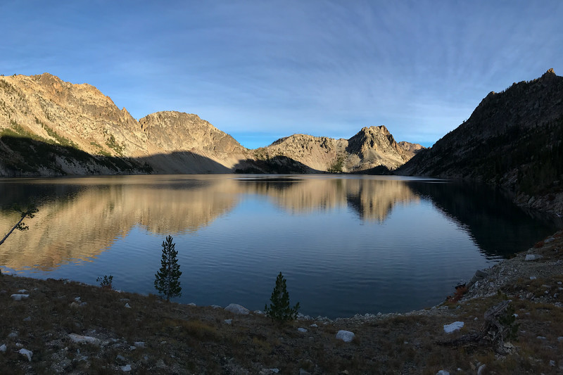Morning sunlight casting undulating shadows and reflections at Sawtooth Lake.