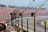 The middle of the stands is not high enough to look over the steel cable reinforced fence that protects the Indy crowd from jumping cars.  The utility of this barrier was demonstrated during the race when a car went airborne and hit the fence.