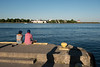 A fine evening for people and shadows on the pier.