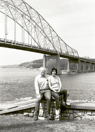 """One of my guilty pleasures is rooting around in old negatives, slides, and prints. I spend way more time than I should scanning and restoring  """"marginal"""" images. This picture of me and Mali near the old Hastings, Minnesota bridge is a perfect example. The Hastings bridge was demolished in 2013 so this Ilford Delta 100 35mm black and white shot is now """"historical"""".   Properly developed and stored black and white negatives will last decades and possibly centuries. How many of your cell phone selfies will survive that long?"""