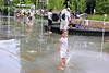 Kids running through sprinklers in Citygarden.  The little girl in the foreground enjoyed posing.