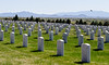 Looking south from Santa Fe's national military cemetery. The Ortiz and Sandia mountains are on the horizon.
