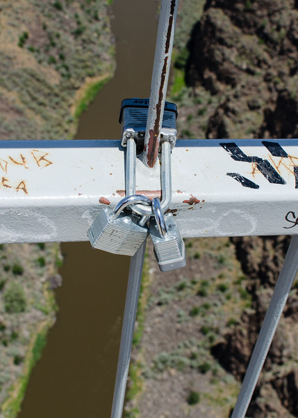 Locks on the Taos Rio Grande Gorge Bridge.  Some people mark promises to themselves and others by attaching locks to bridges. Presumably the promise holds until a key holder releases the lock or rust and time have their way.