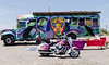 Vehicles parked near the Rio Grande Gorge Bridge: a pink motorcycles and a hippy bus. What's not to like?