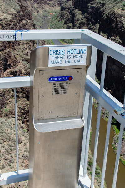 """I got a kick out of the """"give us a call before you jump"""" phones on the Rio Grande Gorge Bridge.  Many of the world's great bridges and high points have been ruined by suicide proofing.  Visiting a suicide proof bridge is like being and animal in a zoo. You're in a cage and your view is wrecked.  I'm happy to report that many bridges in the west still sport """"have at it rails.""""  Anyone that wants to jump from the Rio Grande Gorge Bridge will have no trouble scrambling over the low railing. But remember, before jumping, give us a call."""