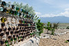 The cement walls around the many of the Taos Earthship houses are anchored with old tires and impregnated with thousands of mostly old beer bottles.  If the residents drank the beer before cementing the bottles them into their fences this is a very happy community indeed.