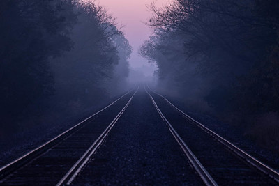 Down the tracks into the morning fog