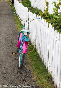 Bicycle along a picket fence