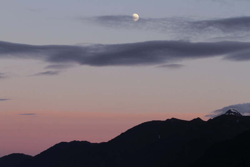 The sits above the mountains surrounding Seward. This photo was taken close to the 11:16 sunset.