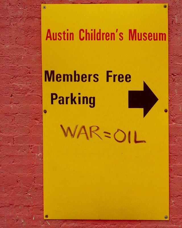 War = Oil,<br /> Austin Children's Museum Parking,<br /> 2nd Street, Austin, TX 2003.